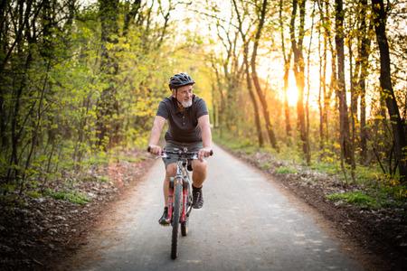 Foto de Senior man on his mountain bike outdoors (shallow DOF; color toned image) - Imagen libre de derechos