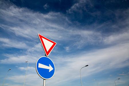 Foto de Road signs against lovely blue summer sky - Imagen libre de derechos