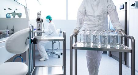 Foto de Flasks with liquids in a lab - Pharmaceutical industry factory and production laboratory (color toned image; shallow DOF) - Imagen libre de derechos