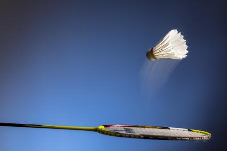 Photo pour Badminton racket and shuttlecock  in motion closeup - image libre de droit