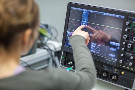 Foto de Female scientist doing research in a quantum optics lab (color toned image) - Imagen libre de derechos