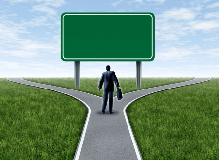 Business decision with a business man at a cross roads and road sign with blank green signage showing a fork in the road representing the concept of direction when facing two equal or similar difficult options.