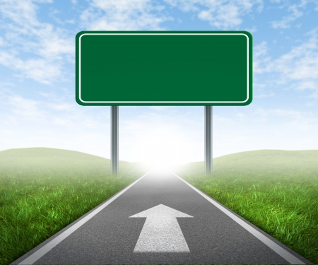 Clear goals on an open straight road highway sign with green grass and asphalt street representing the concept of journey to a focused destination resulting in success and happiness with an arrow on the pavement.