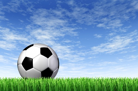 Soccer Ball and grass field background with a blue sky and green european football stadium turf as a concept of fun summer team leisure sport for players who like to kick a sphere and score a goal in a net