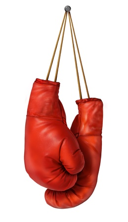 Boxing gloves hanging on a isolated white background with laces nailed to a wall as a business or sport concept of a person that retires gives up the fight or prepares for competition