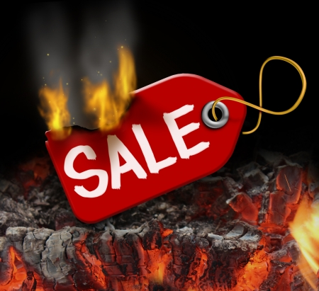Hot sale and liquidation savings concept with a red price tag on fire over burning coals as a consumer symbol of marketing and advertising bargain prices and good value
