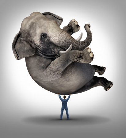 Foto de Leadership solutions business concept with a take charge businessman lifting a huge elephant as a symbol of a strong leader with courage and determination to release the power within and achieve what is impossible  - Imagen libre de derechos