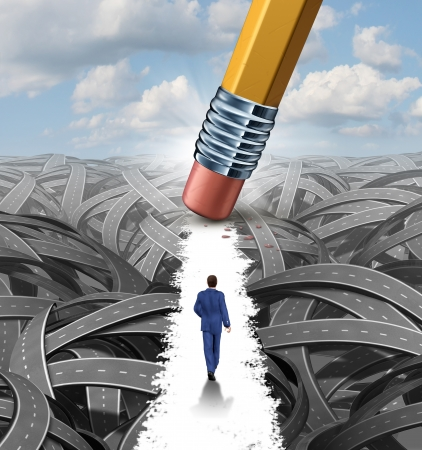 Photo pour Clear the confusion leadership solutions with a businessman walking through a group of tangled roads opened up by a pencil eraser as a business concept of innovative thinking for financial success  - image libre de droit