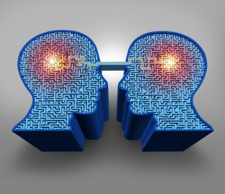 Foto de Teamwork solutions business concept with a group of three dimensional human head shaped maze or labyrinth puzzles with a connected glowing line of communication between the partners as a symbol of team success  - Imagen libre de derechos