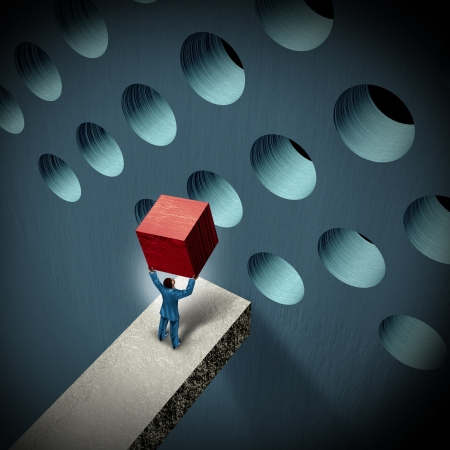 Photo pour Business management challenges concept with a businessman holding a cube trying to make it fit in a round hole as a symbol of overcoming obstacles and adversity through strategy and strong leadership  - image libre de droit