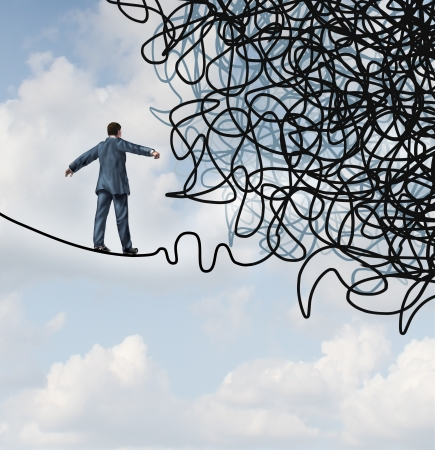 Foto de Risk confusion business concept with a businessman on a high wire tight rope walking towards a tangled mess as a metaphor and symbol of overcoming adversity in strategy and finding solutions through skilled leadership facing  difficult obstacles  - Imagen libre de derechos
