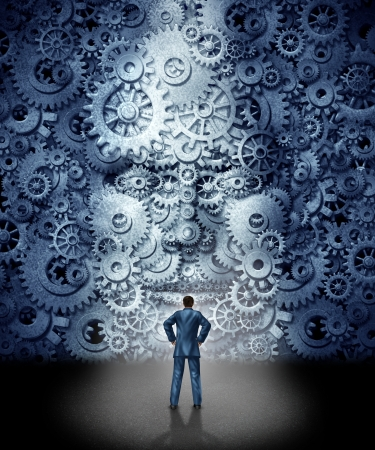 Foto de Business leadership training concept as a businessman facing a huge human head made from gears and cog wheels connected together as a symbol of industry skills education and entering a new career with the assistance of coaching and guidance  - Imagen libre de derechos