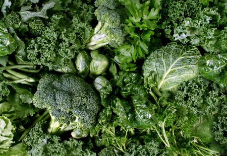 Green vegetables and dark leafy food background as a healthy eating concept of fresh garden produce organically grown as a symbol of health as kale swiss chard spinach collards broccoli and cabbage