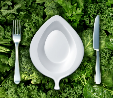 Photo for Eating green vegetables and healthy diet concept with a fork knife and plate shaped as a leaf as a dinner setting on a group of dark leafy greens as a symbol of natural nutrition and a health based diet to fight cancer and live a long life  - Royalty Free Image