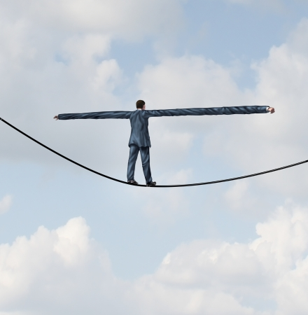 Foto de Adjust to risk with leadership solutions as a businessman with extremely stretched out arms for better balance walking on a tight rope to succeed at the road ahead as a business concept of adapting to challenges for strategy success  - Imagen libre de derechos