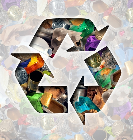 Foto de Recycle garbage concept and Recycling waste management icon shaped with reusable old paper glass metal and plastic household products to be reused helping with environmental conservation for saving energy and money. - Imagen libre de derechos