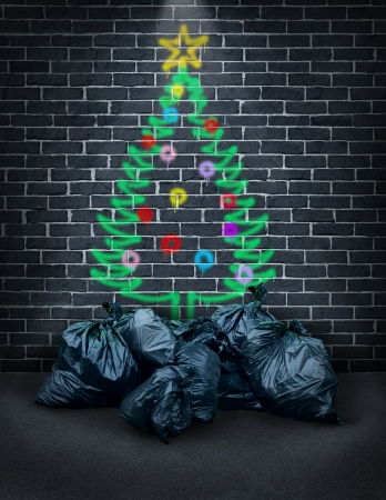 Foto de Poverty during the holidays as a concept for social issues of charity and in regards to financial challenges of poor families and the homeless as a spray painted graffiti of a christmas tree on a city brick wall with garbage bags as gifts  - Imagen libre de derechos