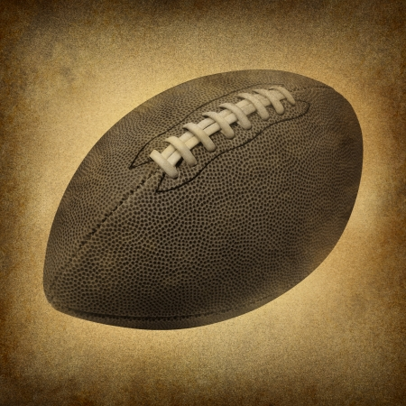 Old grunge football as a vintage antique sports symbol on a dirty parchment  an American cul mural