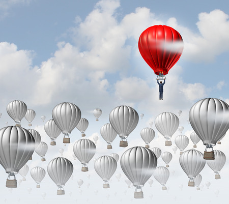Foto de The best leadership concept with a group of grey hot air balloons in the sky and a red aircraft guided by a business leader rising above the competition as a success metaphor for leadership  - Imagen libre de derechos