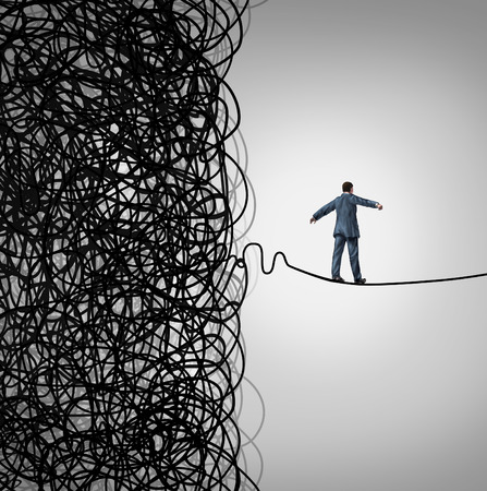 Foto de Crisis Management business concept as a tightrope walker walking out of a confused tangled chaos of wires breaking free to a clear path of risk opportunity as a metaphor for managing organizational challenges for financial freedom and success  - Imagen libre de derechos