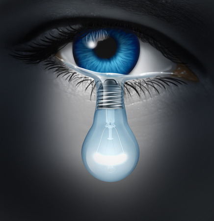 Foto de Depression therapy concept as a depressed human eye crying a tear shaped as a light bulb as a metaphor for solutions in the the treatment of mental health issues through psychotherapy or medication healing. - Imagen libre de derechos