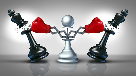 Photo pour New competition business concept with a chess pawn punching and destroying competitors as two king pieces with hidden red boxing gloves  - image libre de droit