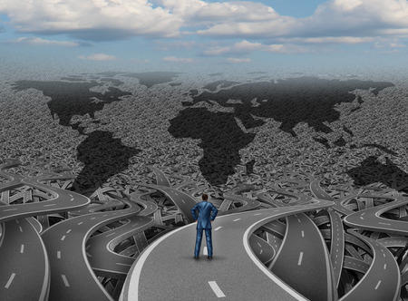 Foto de Global direction and world businessman road concept as a group of tangled highways with a confused man standing on a path to success as a business and economy metaphor for international strategy and planning. - Imagen libre de derechos