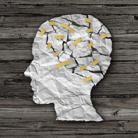 Foto de Brain disease therapy and mental health treatment concept as a sheet of torn crumpled white paper taped together shaped as a side profile of a human face on wood as a symbol for neurology surgery and medicine or psychological help. - Imagen libre de derechos