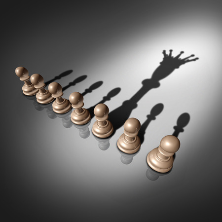 Photo pour Leadership search and business recruitment concept as a group of pawn chess pieces and one individual standing out with a king crown cast shadow as a metaphor for the chosen one. - image libre de droit