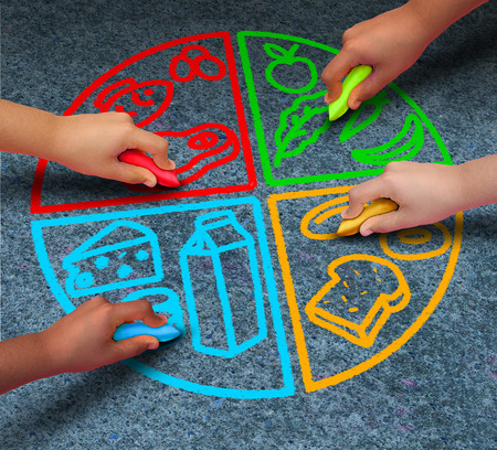 Food groups nutrition and healthy lifestyle concept as a group of diverse children holding chalk drawing a pie chart diagram on asphalt with protein dairy fruits and vegetables and starch symbols.