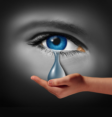 Foto de Depression support and therapy concept as a depressed human eye crying a tear held by a helping hand as a metaphor for solutions in the the treatment of mental health issues through psychotherapy or medication. - Imagen libre de derechos
