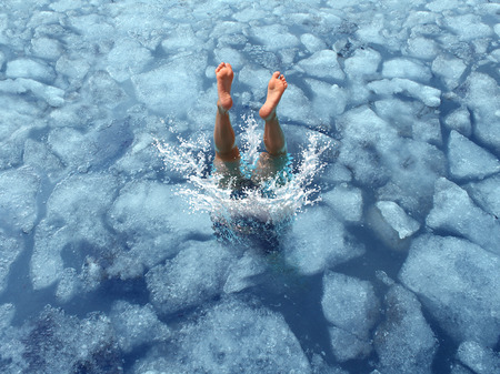 Foto de Cool down and Cooling off concept as a diver diving into frozen ice water as a symbol for managing hot weather summer heat and refreshing break from a heatwave. - Imagen libre de derechos