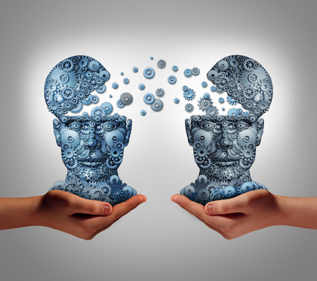Foto de Sharing technology business concept as hands holding two human heads made of gears and cog wheels exchanging information as a symbol and financial metaphor for buying and selling or share data from one company to another. - Imagen libre de derechos