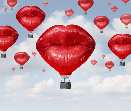 Foto de Love balloons as a hot air balloon made of human red lips soaring up to the blue sky as a surreal dreamy romantic passion concept and emotional trip or freedom discovery travel. - Imagen libre de derechos