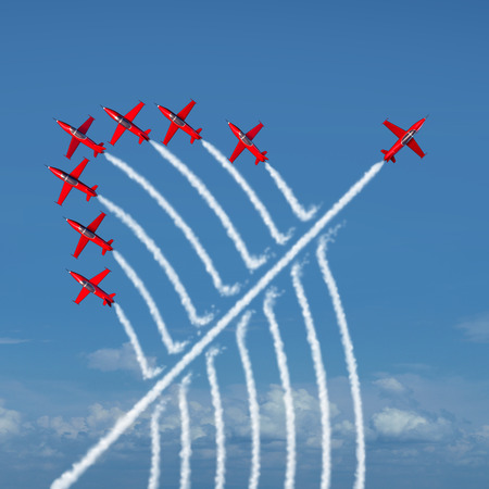 Foto de Disruptive innovation Independent leadership concept and individuality as a group of acrobatic jets with one individual jet going in the opposite direction as a business symbol for new thinking and attitude as a different nonconformist maverick. - Imagen libre de derechos