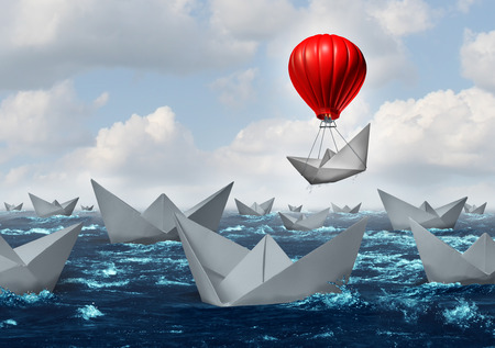 Foto de Business advantage concept and game changer symbol as an ocean with a crowd of paper boats and one boat rises above the rest with the help of a red hot air balloon as a success and innovation metaphor for new thinking. - Imagen libre de derechos