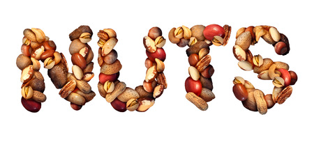Photo for Nuts symbol as letters made with a mixed assortment of raw seeds pecan with walnut brazil nut peanut,hazelnut pistachio almond and cashew as a healthy food symbol and nutritious protein isolated on a white background. - Royalty Free Image