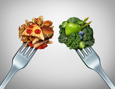 Foto de Diet struggle and decision concept and nutrition choices dilemma between healthy good fresh fruit and vegetables or greasy cholesterol rich fast food with two dinner forks competing to decide what to eat. - Imagen libre de derechos