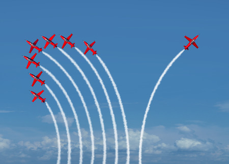 Foto de Independent innovation and new thinking concept or leadership symbol of individuality as a group of flying jet airplanes with one individual airplane going in the opposite direction as a business icon for innovative thinker. - Imagen libre de derechos