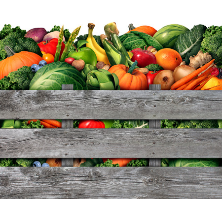 Fruit and vegetable harvest from a farmers market with a group of assorted natural raw fruits and vegetables as healthy organic food in a rustic wood box as a symbol for living a good nutrition lifestyle.