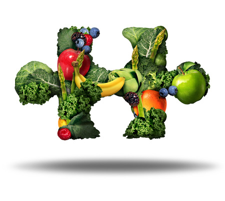 Photo for Healthy food solution and eating fresh fruits and vegetables symbol as raw produce shaped as a puzzle piece on a white background as a natural nutrition lifestyle icon. - Royalty Free Image