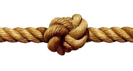 Photo pour Rope knot isolated on a white background as a strong nautical marine line tied together as a symbol for trust and faith and a metaphor for strength or stress. - image libre de droit