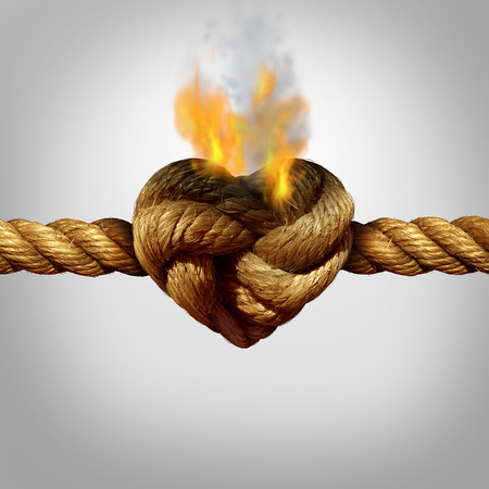 Photo pour Divorce and separation concept as a rope with a burning knot shaped as a love heart as a relationship problem symbol or infidelity crisis icon between a couple. - image libre de droit