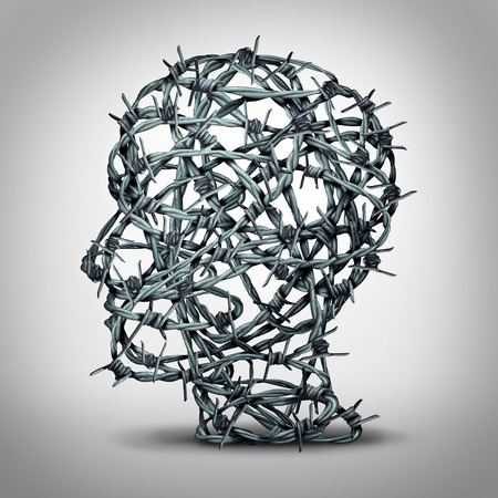 Foto de Tortured thinking and depression concept as a group of tangled barbwire or barbed wire fence shaped as a human head as a metaphor for psychological or psychiatric condition of suffering and victim of oppression or mental illness. - Imagen libre de derechos