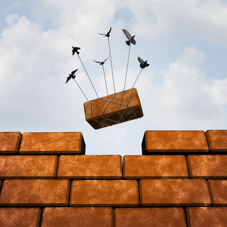 Foto de Build a wall business concept as a group of birds placing a brick to complete a wall as a puzzle metaphor and working together symbol for creating a successful structure with organized strategy and  planning. - Imagen libre de derechos