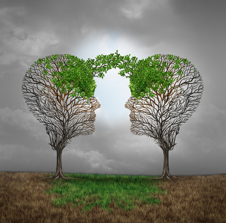 Foto de Mutual support and saving one another as a benefit to each other business concept as two sick trees with new leaves growth emerging shaped as a human head providing a revival for success. - Imagen libre de derechos