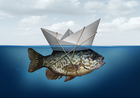 Photo pour Resource optimization concept as a business symbol for utilization of resources to advance and upgrade a success strategy as a paper boat in water tied to a fish as an efficiency system solution. - image libre de droit