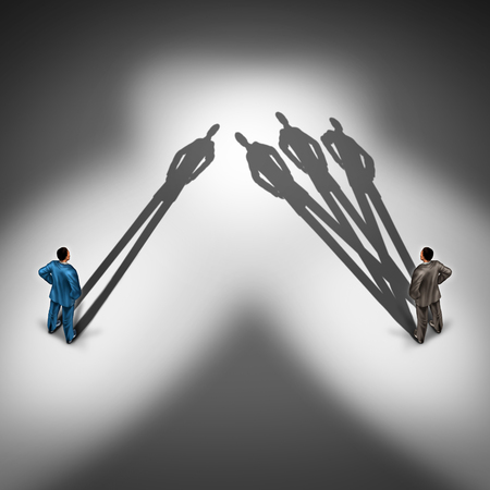 Foto de Worker productivity concept and productive employee symbol as two businessmen with one person with a single cast shadow and another business person with a group of shadows as a skillfull overachiever. - Imagen libre de derechos