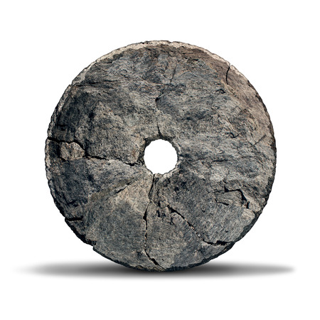 Foto de Stone wheel object as an early invention of the prehistoric era and ancient symbol of technology and innovation designed by a caveman on a white background. - Imagen libre de derechos