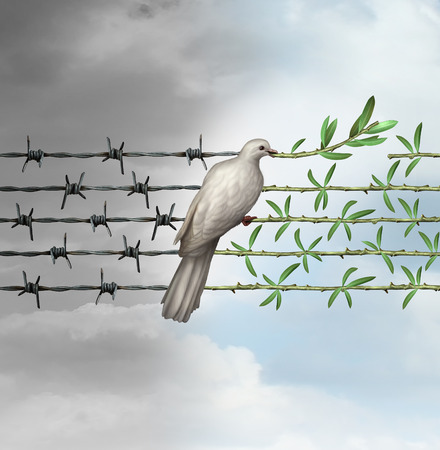Photo pour Hope concept as a dove perched on barbed wire transforming into an olive branch as a symbol for good will towards man and a respect for humanity and the globe as a new year or holiday greeting with a wish and dream of a safer world. - image libre de droit